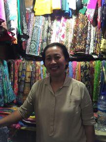 Ubud textile market shopkeeper